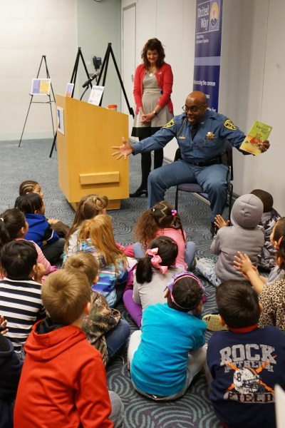 Sheriff Herman Jones reads to students at the 30,000 book celebration