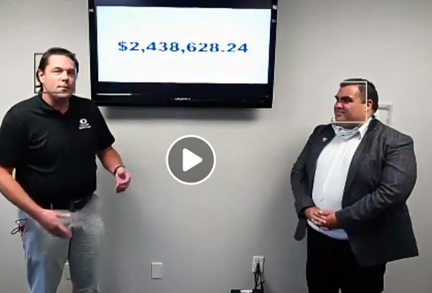 Screen capture from the live Facebook broadcast of the Campaign Celebration. Campaign Chair John Fager and VP for Resource Development Angel Romero flank a screen showing the 2020 total amount raised of $2,438,628.24.