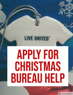 The words Apply for Christmas Bureau on top of a Christmas ornament of a Live United t-shirt