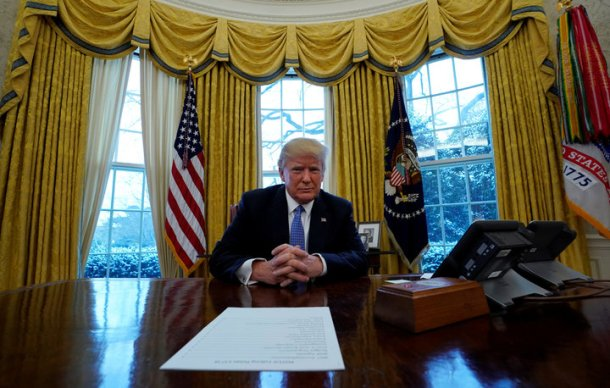 U.S. President Donald Trump sits at his desk during an interview with Reuters