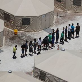 Reporters tour tent city that's housed thousands of migrant teens: 'They treat us well, thank God'
