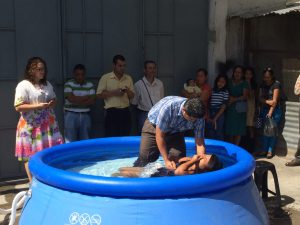 Monica being baptised by Pastor Jorge!