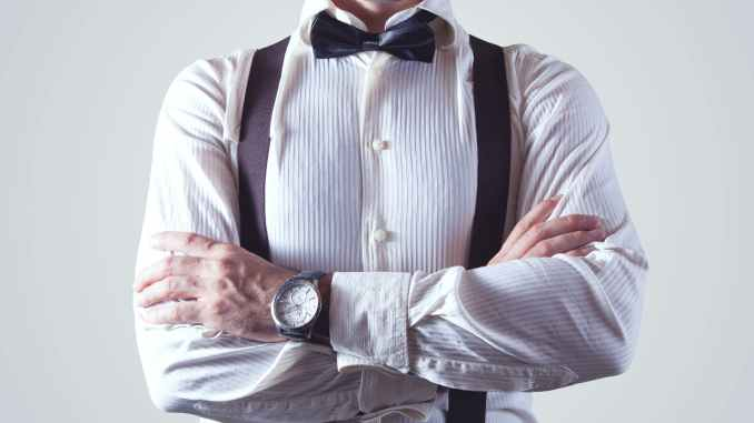 bow tie businessman fashion man- with a watch shawing time.