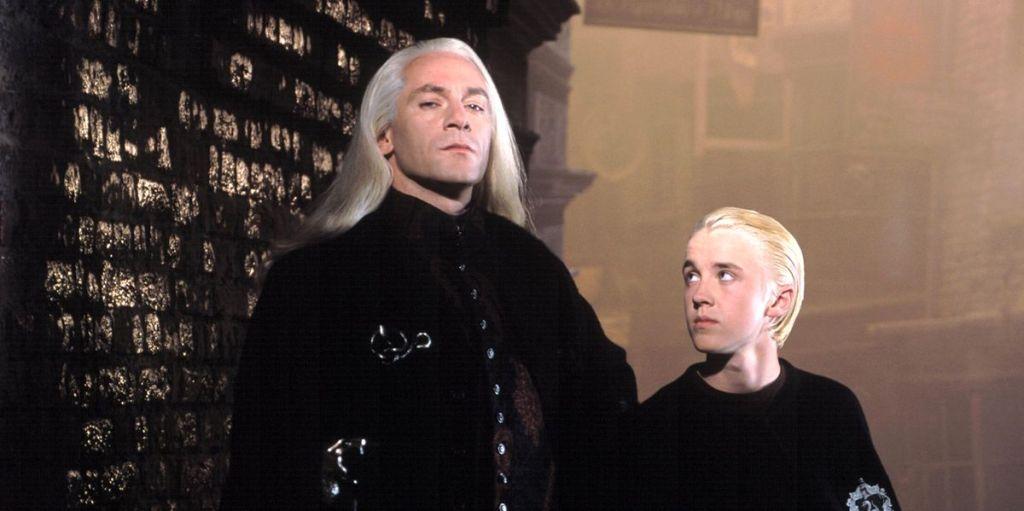 Jason Isaacs as Lucius and Tom Felton as Draco