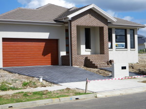 A new home showing the entry with six steps to the front door.