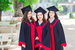 Three female students graduating from post secondary education..