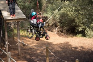 a person in a wheelchair is on the flying fox highlighting universal design at Camp Manyung.
