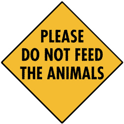 The sign says Please do not feed the animals