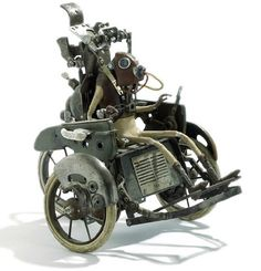 a very mechanical looking wheelchair with a metal person with skinny spiderlegs