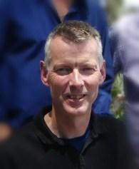 head sand shoulders shot of Professor Rob Imrie