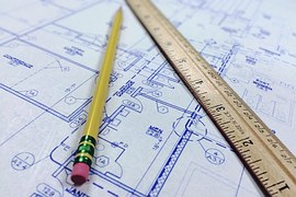 Architecture blueprint with rule and pencil. Are architecture educators teaching universal design.