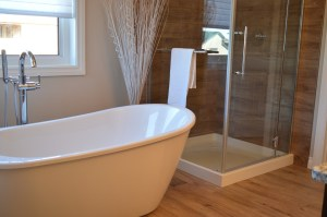 picture of a free standing bathtub with a shower behind in teh corner
