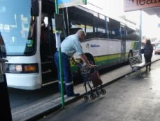 Bus driver helps woman with her wheelie walker