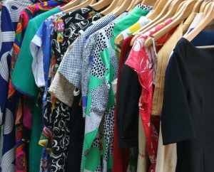 Picture of a rack of dresses in all kinds of fabric designs