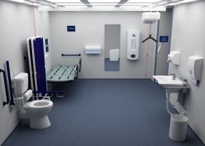 Changing Places toilet showing the change table, the hoist and the toilet with drop down grab bars