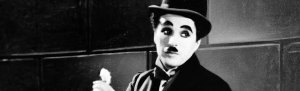 Black and white photo of Charlie Chaplin from silent movie days
