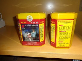 picture of two fire escape masks in bright yellow and red