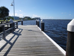 Timber planked pier leading to the ocean. Access to natural waterfront landscapes.