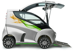 White box shaped vehicle with green trim, shown here with the lid style front door raised