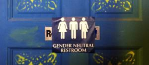 Gender Neutral restroom sign showing three figures