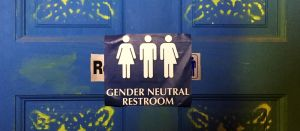 Gender Neutral restroom sign showing three figures