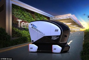 A small black and white pod shaped automated driverless vehicle.