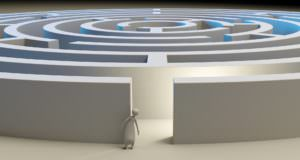a circular maze or labyrinth with a person looking into it