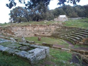 The photo is of the remains of the Roman Theatre. This is a stone semicircular ampitheatre that has been uncovered by archaeologists.