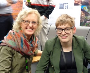 Jane Bringolf and Kelly Vincent after the universal design forum in a head and shoulders shot. Both are wearing dark green and glasses.
