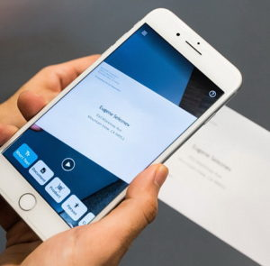Picture of an iPhone magnifying a business card