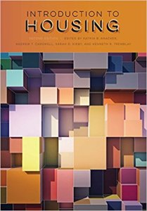 Front cover of book showing lots of different sized and coloured cubes stacked. The title banner is in dark yellow