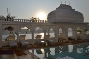 Indian hotel swimming pool at sunset.