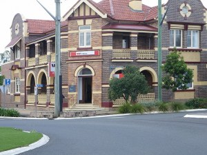 A Westpac bank branch in NSW country town. It is a large old two storey house with steps to the entrance