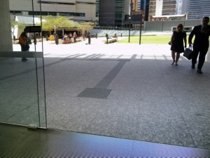 two people are walking towards a door that automatically opens. Invisible universal design.