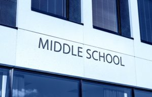 Close up of a school building with the words, middle school.