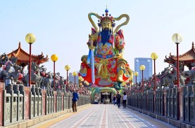Brightly coloured temple at the end of a long walkway in Taiwan.