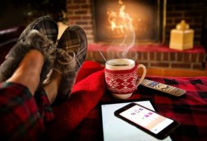 A fireside, a hot drink in a mug and slippered feet up on the recliner.