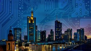 A city skyline at night against a backdrop of a computer circuitry board.