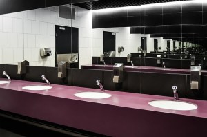 A row of handbasins in a public toilet.