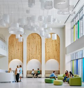 A large reception area with soft seating in the new hospital.