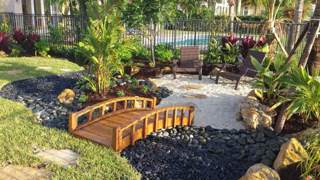Asian style garden inside a tropical backyard with pool ... on Tropical Backyard Landscaping  id=59004