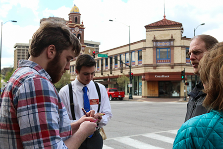 #OneDayKC participants speak with members of the public to gather feedback on their ideas. Photo by Chandler Eaton.