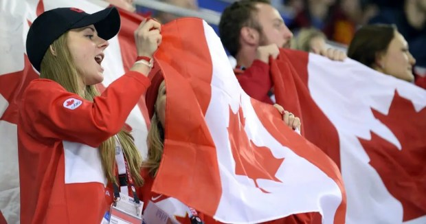 Student waving Canadian Flag