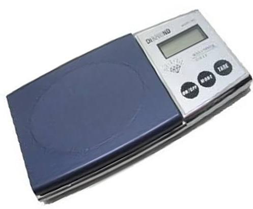 Como saber se o peso do braço do seu toca-discos está legal? Que tal usar uma balança de precisão?