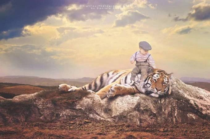 bimbo con tigre