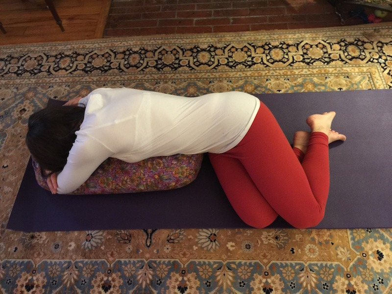 Reclining Twist With Yoga Bolster