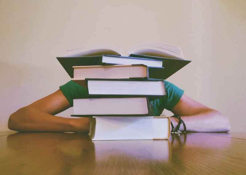 Burnout of Medical Students Pile of Books