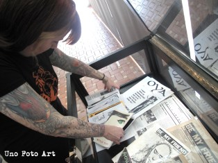 Kim arranging some early examples of San Diego zines.
