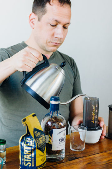 Ray brewing an aeropress of the Tequila Barrel Aged Starter Coffee