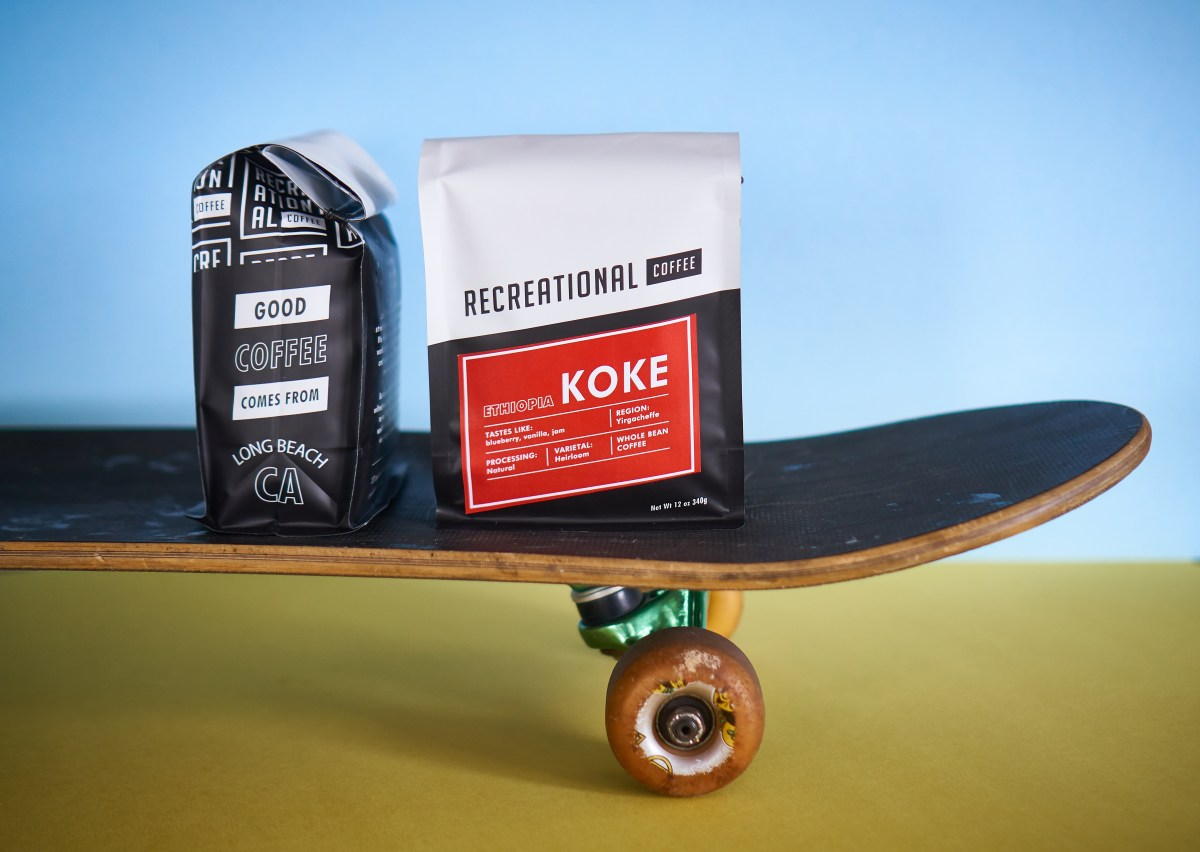 two coffee bags atop a skateboard